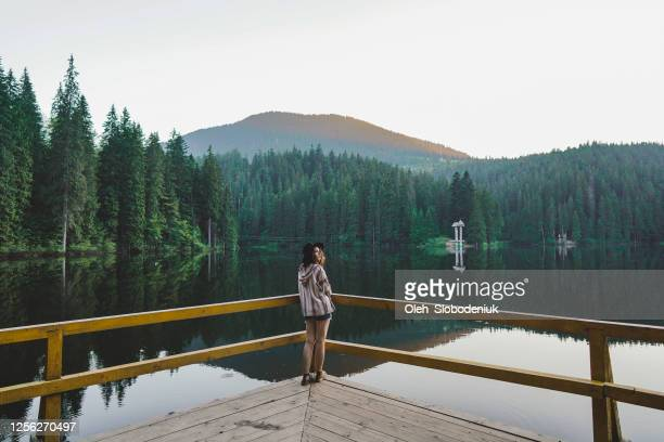 woman near the synevir lake - ukraine landscape stock pictures, royalty-free photos & images