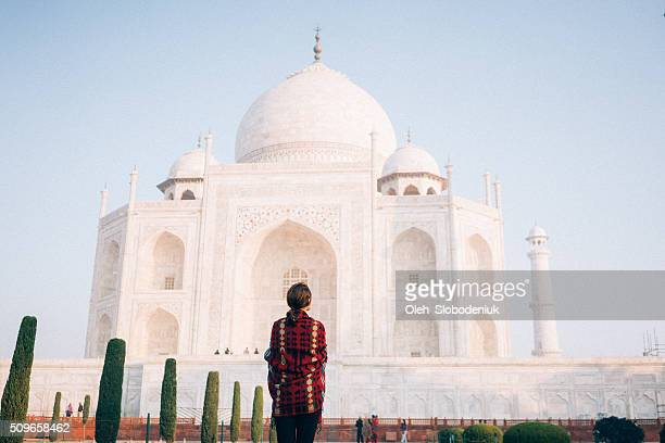 woman near the taj mahal - taj mahal stock photos and pictures