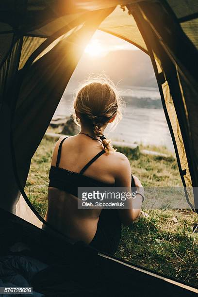 Woman near  the tent