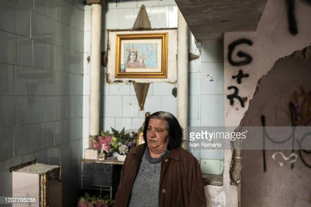 A woman near the votive shrine dedicated to the Madonna dell'Arco inside the Red Sail on February 20 2020 in Naples Italy The Vele of Scampia are a...