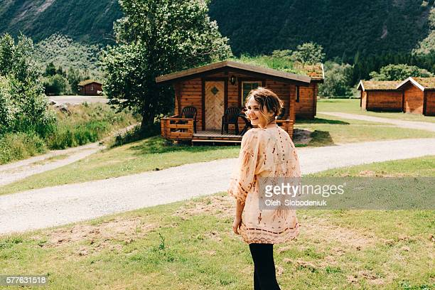 Woman near the wooden house