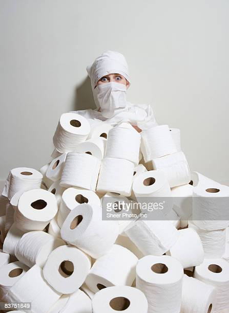 woman neck-deep in toiletpaper - funny toilet paper stock pictures, royalty-free photos & images