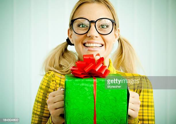 Woman nerd holding a present.