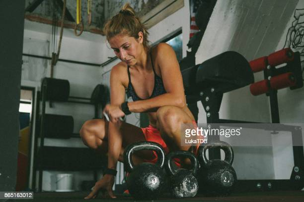 Woman next to kettlebell