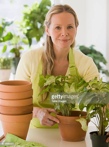 Woman next to potted plants