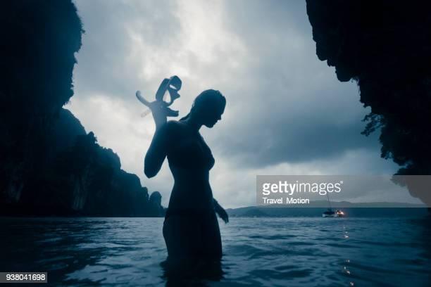 Woman night snorkeling at Phi Phi Island, Thailand
