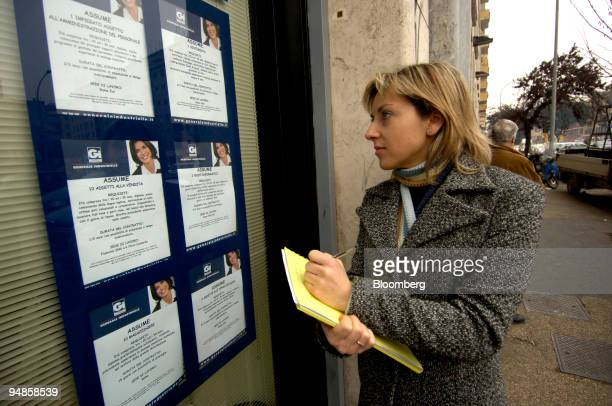 A woman notes job vacancy details outside the Generale Industrielle Temporary Employment Agency in Rome Wednesday February 9 2006 Temporary and...