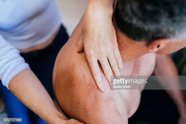 woman nursing her husband. - erotische massage stockfoto's en -beelden