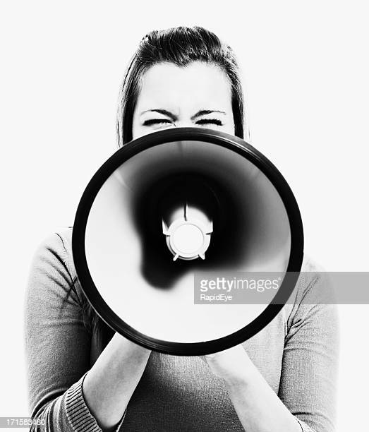 Woman obscured by megaphone she holds