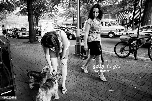 CONTENT] Woman observes another woman petting a dog in Shirlington in Northern Virginia