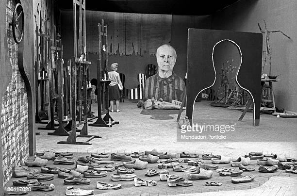 Woman observing the installation Reminiscences by Polish artist Jozef Szajna at the 35th Art Biennale. Venice, 1970.