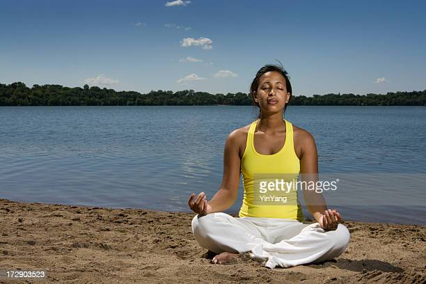 Woman of African Descent Practicing Yoga, Zen Meditation on Beach