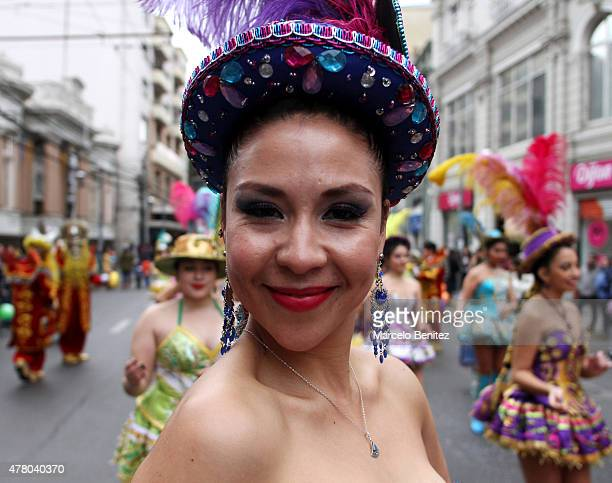 "A woman of an Andean community smiles during her performance on the street during 'Inti Raymi"" celebration on June 21 2015 in Valparaiso Chile Inti..."