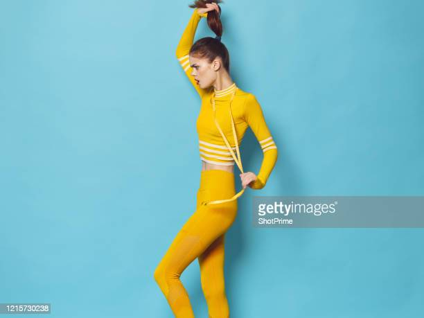 a woman of athletic build measures herself in height, length and width. well, she watches her figure oh and sheds weight. - championships stock pictures, royalty-free photos & images
