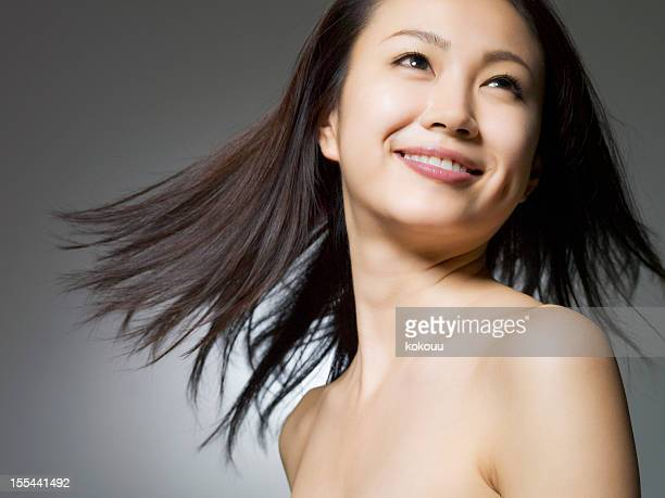 woman of black hair turns - east asia stock pictures, royalty-free photos & images