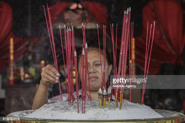 A woman of Chinese descendant prays as a part of Lunar New Year celebration in the Sam Poo Kong temple in Semarang Central Java Indonesia on February...