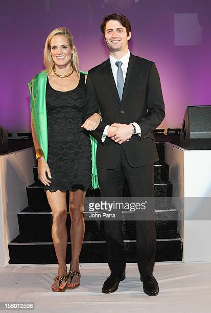 Woman of Substance and Style Honoree Dara Torres poses with celebrity presenterJames Lafferty at Destination Fashion 2012 To Benefit The Buoniconti...