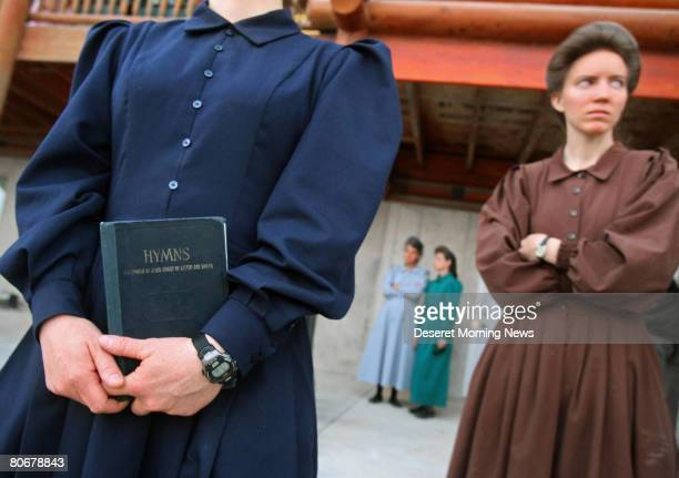 A woman of the Fundamentalist Church of Jesus Christ of Latter Day Saints holds a hymn book which is the only thing she was allowed to take when she...
