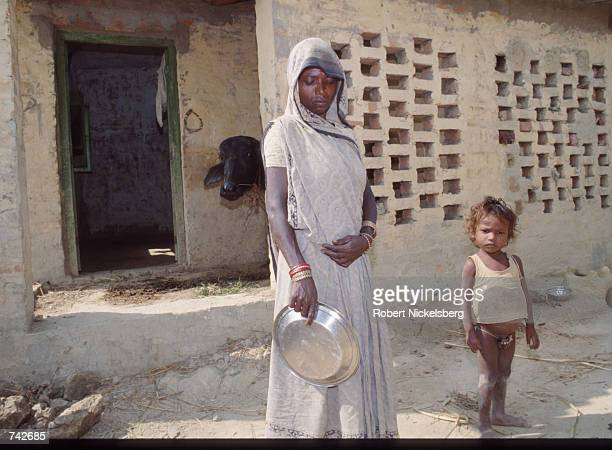 A woman of the Harijan caste stands October 28 1991 in India The Harijan caste is the lowest in the Hindu class hierarchy and its members are often...