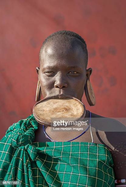 woman of the mursi tribe with disc in her lower lip, omo valley, ethiopia - lip plate stock photos and pictures