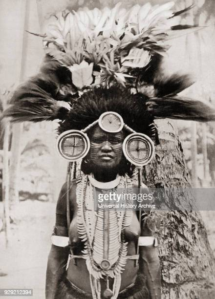 A woman of the Roro tribe from Papua New Guinea Melanesia decorated for a ceremonial dance After a 19th century photograph From Customs of The World...