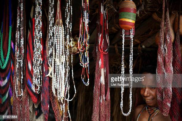 A woman of the traditional Dani tribe from Lembah Baliem stands by bead necklaces and traditional bags called Noken on October 10 2009 in Wamena West...