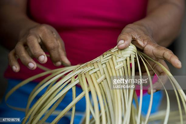 A woman of the Wounaan Nonam indigenous ethnic group takes part in the crafts making competition during the 10th Meeting of the Ancestral Knowledge...