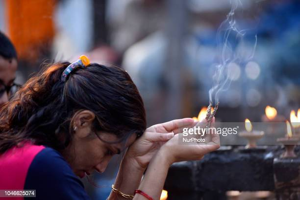 A woman offering fragrance sticks in the Kaal Bhairab statue at Basantapur Durbar Square Kathmandu Nepal on Saturday October 06 2018