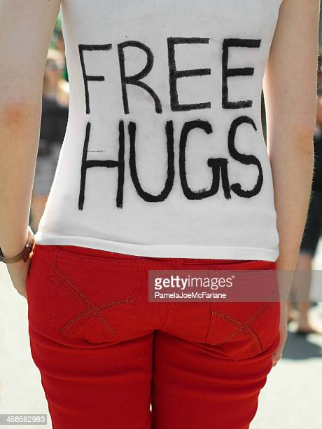 woman offering free hugs - stranger stock photos and pictures