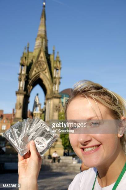 A woman offers free samples of hair conditioner at the Prince Albert Memorial