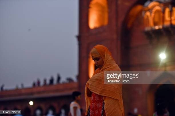 A woman offers prayer on the eve of EidulFitr at Jama Masjid on June 4 2019 in New Delhi India With the sighting of the crescent moon the monthlong...