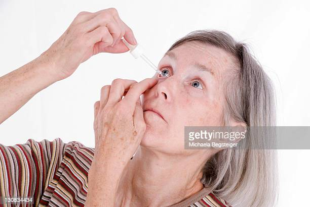 woman, older than 65 years, using eye drops - 65 69 years stock pictures, royalty-free photos & images