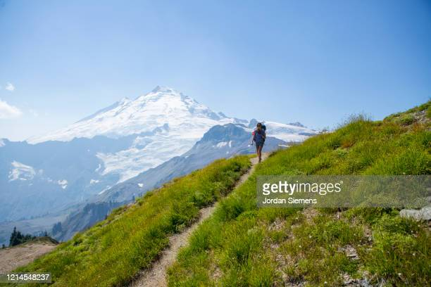 a woman on a backpacking trip in the mt baker wilderness. - bellingham stock pictures, royalty-free photos & images