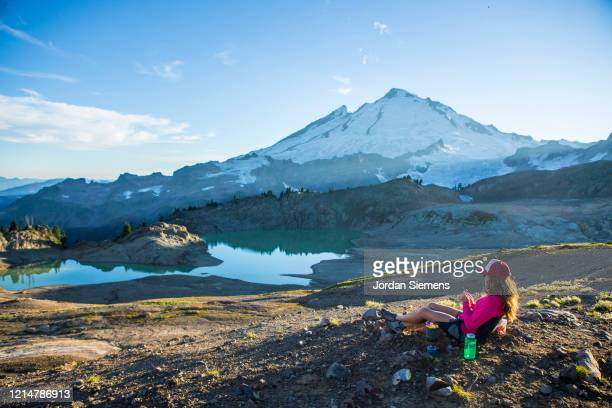 a woman on a backpacking trip near mt. baker. - bellingham stock pictures, royalty-free photos & images
