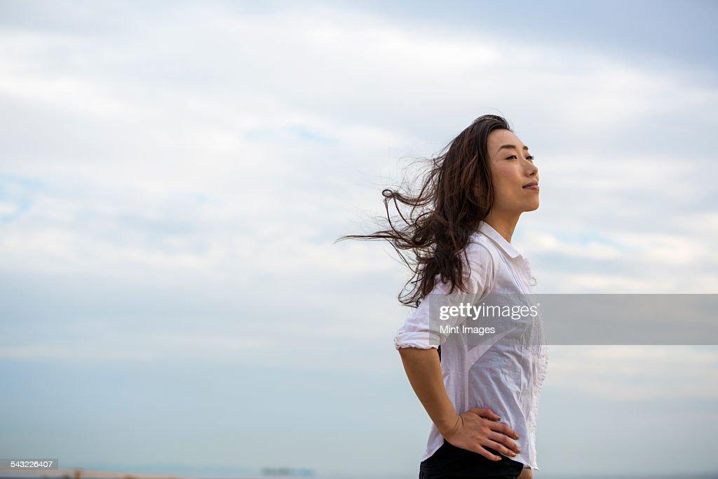A woman on a beach in Kobe. : Stock Photo