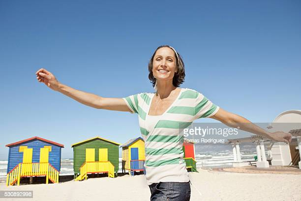 woman on a beach - one mature woman only stock pictures, royalty-free photos & images
