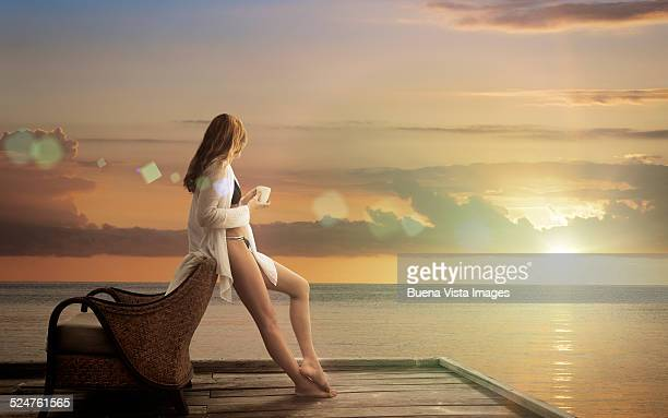 Woman on a beach watching sunset