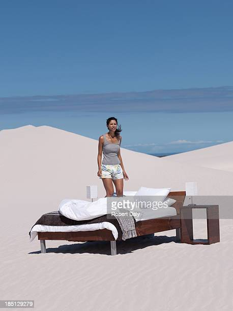 A woman on a bed outdoors