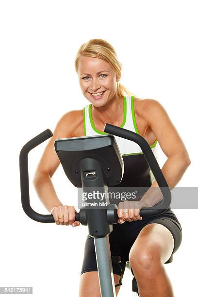 Woman on a bicycle ergometer -