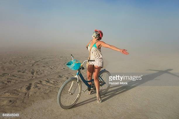 a woman on a bike in the desert - playsuit stock pictures, royalty-free photos & images