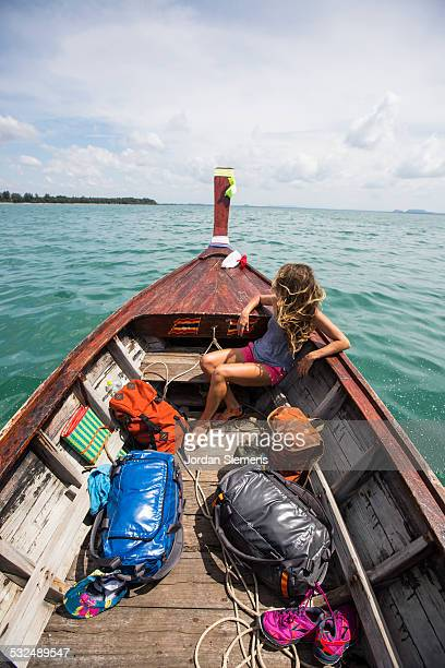 a woman on a boat adventure. - asiatisches langboot stock-fotos und bilder