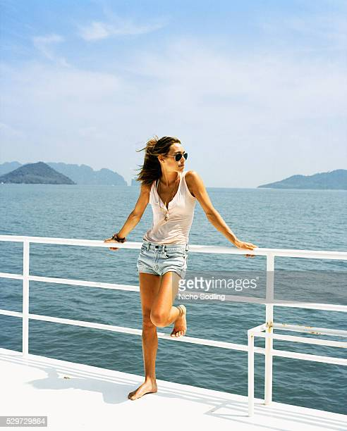 a woman on a boat - passenger craft stock pictures, royalty-free photos & images