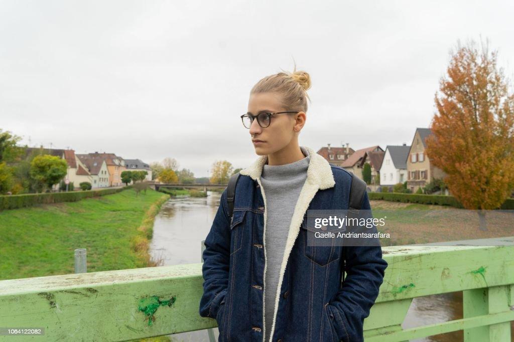 Woman on a bridge near the Rhine : Stock Photo