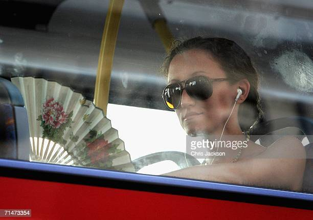 Woman on a bus fans herself to keep cool on July 18, 2006 in London, England. Temperatures soared across Britain on what may turn out to be one of...