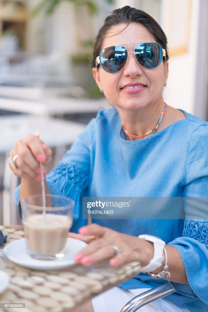 Woman on a cafe in Italy : Stock Photo