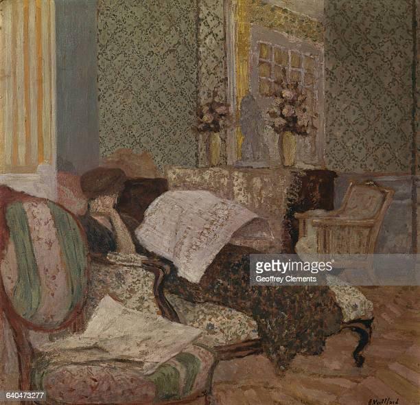 Woman on a Divan Reading a Newspaper by Edouard Vuillard