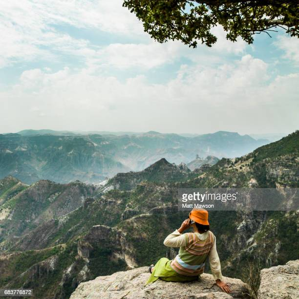 A woman on a mobile phone overlooking the Copper Canyon Chihuahua State Mexico