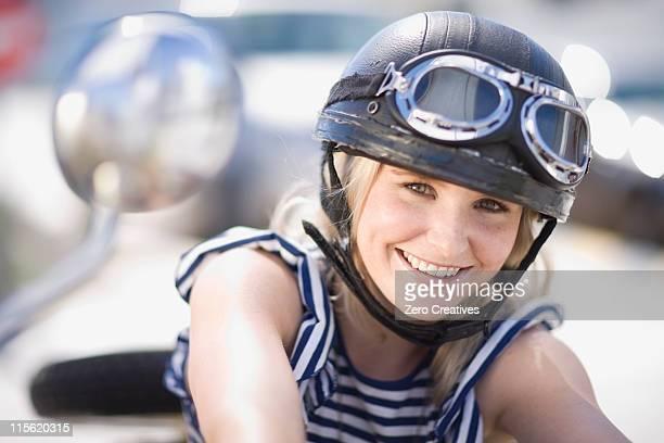 woman on a motorbike - スポーツヘルメット ストックフォトと画像