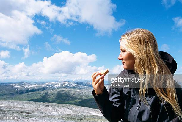 Woman on a mountain tour having a break Norway.