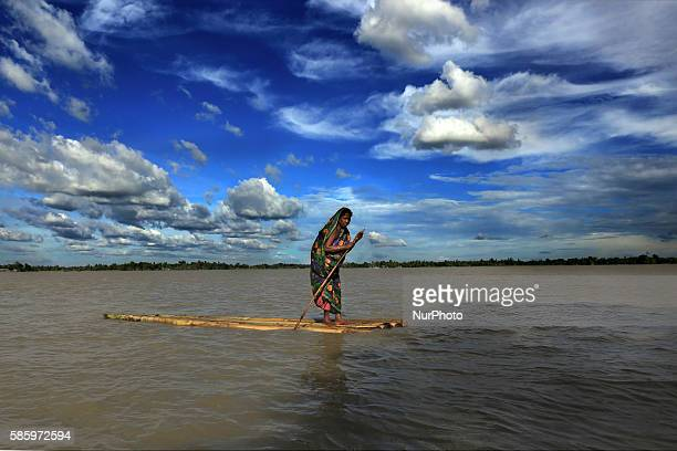 Woman on a raft approaches a boat.
